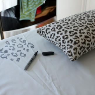 Sharpie Snow Leopard Fabric into an Ottoman